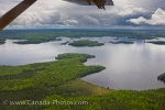 An aerial view from a De Havilland DHC-3 Otter aircraft shows wilderness lakes, islands and the forest in Northern Ontario.
