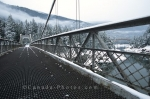 Winter in British Columbia while standing at the Alexandra Suspension Bridge near Yale with the Fraser River below.