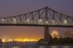 The night illumination of Jacques Cartier Bridge and La Ronde Amusement Park in the City of Montreal in Quebec, Canada.