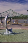The giant Atlantic Salmon statue adorns the waterfront of the Restigouche River in Campbellton, New Brunswick in Canada.
