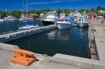 Boats line the docks at the marina in the town of Baddeck in the center of Cape Breton along the Cabot Trail in Nova Scotia, Canada.