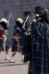 The troops march in at the Halifax Citadel National Historic Site in Nova Scotia, Canada as a bagpiper plays for them.