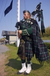 A bagpiper plays his music while dressed in his entire Scottish uniform at the Halifax National Historic Site in Nova Scotia, Canada.