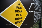 A sign warning people of the consequences of feeding a bear in Wells Gray Provincial Park in British Columbia, Canada.