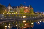 A calm evening reveals reflections of the grand and elegant Empress Hotel, situated along the waterfront  in the inner harbour of Victoria - the beautiful capital city of British Columbia, Canada.
