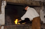 A demonstration of the work done by a blacksmith in the forge at the Fortress of Louisbourg in Cape Breton, Nova Scotia.