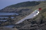 A long boat ladder makes it way to the water's edge for fisherman to launch their boats into Pouch Cove in Newfoundland, Canada.