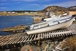 Wooden boat ramps line the harbour of St. Lunaire-Griquet in Newfoundland, Canada so that fisherman can pull their boats out of the salty water.