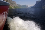 A boat tour heads out along the Western Brook Pond in Gros Morne National Park in Newfoundland Labrador, Canada.