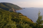 The Cabot Trail in Cape Breton Highlands National Park in Nova Scotia, Canada winds around the coastline overlooking the vast open waters.