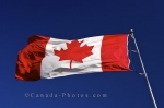 A picture of the Canada flag blowing in the wind at the Information Centre in the town of Wawa in Ontario, Canada.