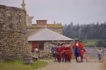 The military procession marches through the streets at the Fortress of Louisbourg in Nova Scotia, Canada before the cannon gun firing.