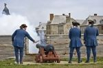 A blast explodes from the cannon gun after being ignited by military soldiers at the Fortress of Louisbourg in Cape Breton, Nova Scotia.