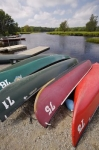 Each canoe laid out on the shore of the Mersey River in Kejimkujik National Park in Nova Scotia is ready to be used for a small rental fee.