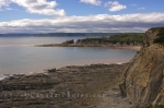 A small cove and the beach area at low tide seen from Cape Enrage along the Fundy Coastal Drive in New Brunswick, Canada.
