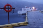 The ferry pulls away from the wharf in Battle Harbour at the entrance to St. Lewis Inlet in Southern Labrador in Canada.