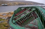 An old fishing boat was placed on the shores at Battle Harbour in Southern Labrador, Canada which has remained here for many years.