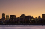 The beautiful colors at sunset reflect off the St. Lawrence River and span the sky over the downtown core of Montreal City in Quebec, making the skyline picturesque from the island of Ile Sainte-Helene.