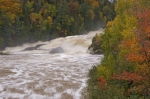 A flood of water rushes down the Chippewa River in Ontario, Canada when an Autumn storm passed through Ontario, Canada.