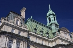 A partial picture of the facade of the Montreal City Hall (Hotel de Ville) along the Rue Notre-Dame in Old Montreal, Quebec in Canada.