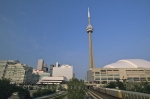 A panoramic view of the CN Tower flanked by the Skydome Stadium, from downtown Toronto, Ontario.