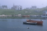 Small harbor in fog along the lighthouse route on the atlantic coast in Nova Scotia, Canada