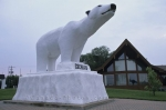A large polar bear statue stands tall and welcomes visitors into the town of Cochrane, Ontario.