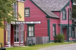 Visitors can wander the Main Road in the historic Sherbrooke Village Museum in the town of Sherbrooke in Nova Scotia, Canada and explore the colorful buildings.