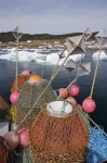 All the equipment needed for crab fishing is loaded onto Bromley's Venture which awaits the thawing of the pack ice before leaving Conche Harbour in Newfoundland, Canada.
