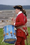 A drummer performs in a military procession before the cannon gun is fired at the Fortress of Louisbourg in Cape Breton, Nova Scotia.