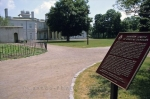 An information sign and the pathways leading to the Dundurn Castle in downtown Hamilton in Ontario, Canada.