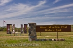 Flags and signs decorate the entrance to the Wood Mountain Post Provincial Historic Park in Saskatchewan, Canada.