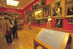Famous paintings adorn the walls of the Art Gallery in Toronto, Ontario where visitors stand in awe of the masterpieces.
