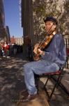 A fiddler loves playing for the crowds that stroll along the Rue Notre-Dame in Old Quebec in Quebec City, Canada.