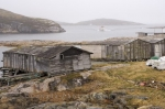 Old fishing shacks sit along the waterfront of Battle Harbour at the entrance to St. Lewis Inlet in Southern Labrador, Canada.
