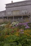 A flower garden adorns both sides of the stairs at a property along the waterfront in the town of Margaretsville in the Bay of Fundy in Nova Scotia.
