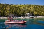 A zodiac takes passengers in towards Flowerpot Island in Fathom Five National Marine Park in Ontario, Canada where they can get a closer look at the sea stacks.