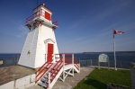 On the south side of St. John's Harbour on the Avalon Peninsula in Newfoundland, Canada, stands the Fort Amherst Lighthouse, a popular attraction along Fort Amherst Road.