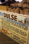 Bags of fresh Dulse, a sea vegetable, displayed in bags at a market stall at the City Market in Saint John, New Brunswick.