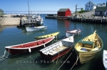 A picturesque fishing village with colourful boats and houses, Bay of Fundy, high tide, Halls Harbour, Nova Scotia, Canada, North America.