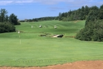 A putting green and a hilly fairway at the House of Green Gables Golf Course in Prince Edward Island, Canada.