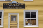 The sign outside of these accommodations welcomes visitors to Aunt Jane's Bed and Breakfast and to browse the gift store in Gros Morne National Park in Newfoundland.