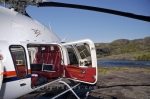 A helicopter is preparing for departure atop the Mealy Mountains in Southern Labrador after passengers have explored the landscape.