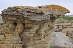 A close up picture of a hoodoo that is a unique rock formation found along the Hoodoos Interpretative Trail in Writing on Stone Provincial Park in Southern Alberta, Canada.