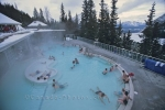 In the snow covered region of Banff National Park in Alberta, Canada, people enjoy the warmth of the water at the Hot Springs.
