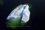 An aerial shot of an iceberg floating in a bay along the coast of Southern Labrador near Charlottetown in Labrador, Canada.