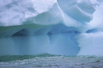 Blue icebergs floating along the coast of Newfoundland -this iceberg stranded in the Notre Dame Bay.