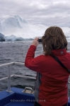 A tourist aboard the Gaffer III that departs from St. Anthony, Newfoundland in Canada that takes passengers to see the scenery of Iceberg Alley.