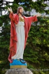 A statue of Jesus adorned in a bright red cloak, stands in the cemetery at the St. Boniface Cathedral in the City of Winnipeg in Manitoba, Canada.