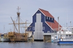 The unique shaped blue and red building in Bonavista, Newfoundland is a storage home for the Matthew, a replica of John Cabot's ship that he sailed in 1497.